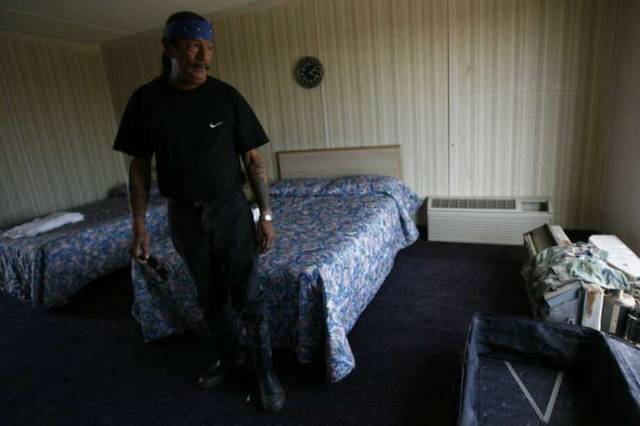 Armondo Briones, 51,stands in his room at the Crystal Palace Resort Wednesday in Crystal Beach. The Texas National Guard delivered Meals Ready to Eat and water to the five people who refuse to leave the hotel where they rode out the storm. An estimated dozen people steadfastly remain on the Bolivar Peninsula. Photo: Sharon Steinmann, Chronicle