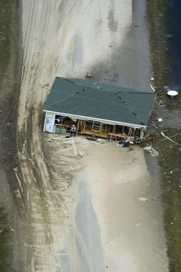 A house lies across Highway 87 near Crystal Beach Monday. Photo: Smiley N. Pool, Chronicle