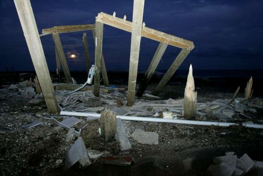 An electrical box hangs from stilts that supported a house before Hurricane Ike roared across the Bolivar Peninsula. Photo: Tony Gutierrez, AP