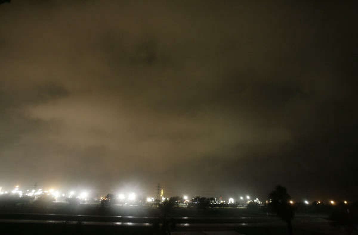 Clouds cover the Dow Chemical Plant along Highway 332 in Lake Jackson hours before expected landfall on Friday.