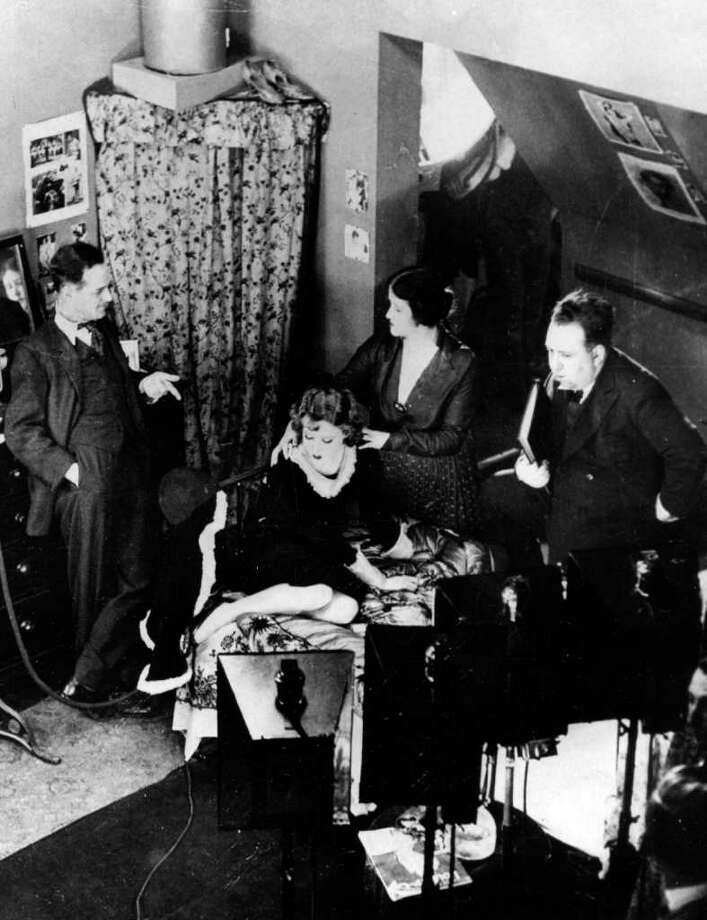 "FILE - In this 1929 file photo, British director Alfred Hitchcock, right, is pictured at the set directing the first British full-length talking picture ""Blackmail.""  The New Zealand Film Archive and the National Film Preservation Foundation announced the discovery of the 1923 film ""The White Shadow,"" thought to be the earliest surviving feature by Alfred Hitchcock. (AP Photo, file) Photo: STF / 1929 AP"