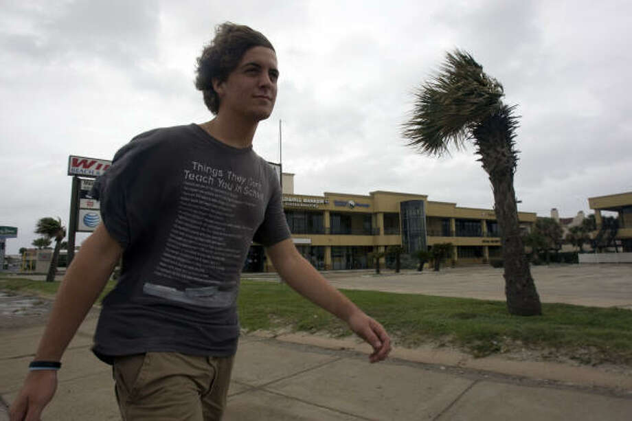 Chris Truitt, 18, walks down Seawall Boulevard with winds picking up as Hurricane Ike approached Galveston. Photo: Johnny Hanson, Chronicle