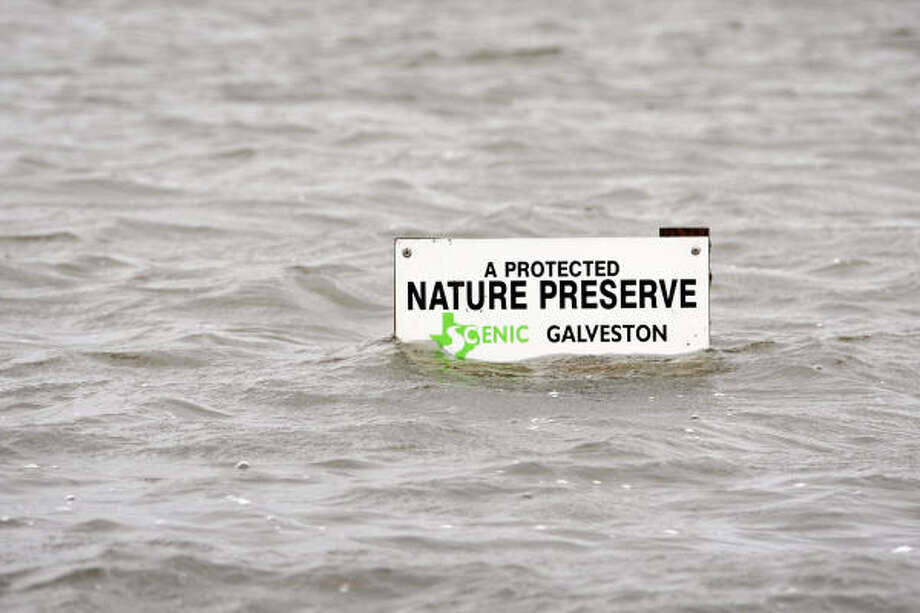 Floodwaters in Texas City nearly cover a nature preserve sign Friday. Photo: Scott Olson, Getty Images