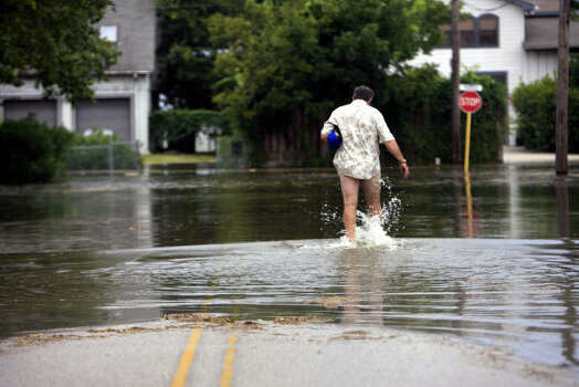 A man walks through surge waters in Seabrook as Hurricane Ike approaches Friday. Photo: Eric Kayne, Chronicle