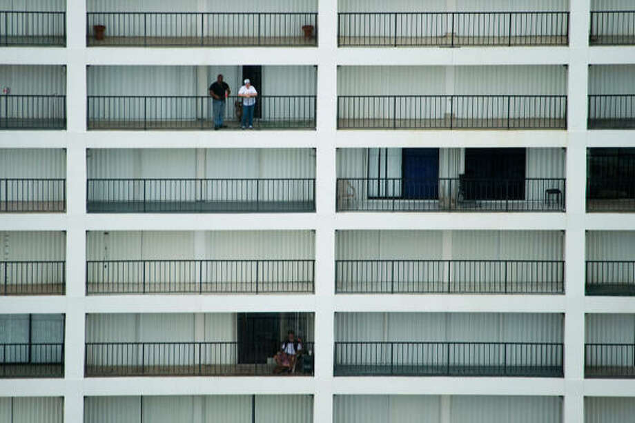People watch the approach of Hurricane Ike from the balconies of a high rise on Galveston's seawall Friday. Photo: Smiley N. Pool, Chronicle