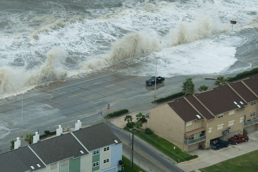 Waves crash over the seawall on Galveston Island.