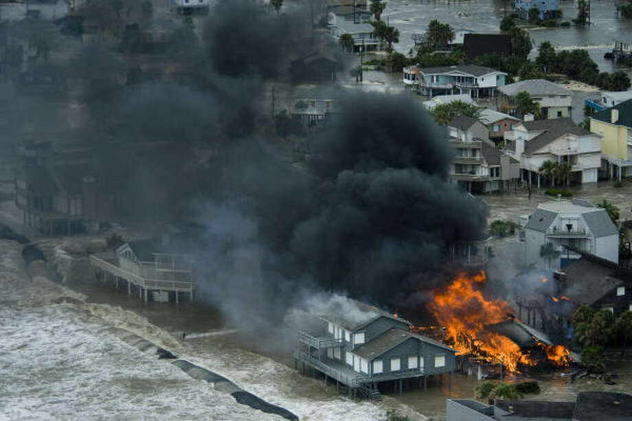 A house burns on Galveston Island. Photo: Smiley N. Pool, Chronicle