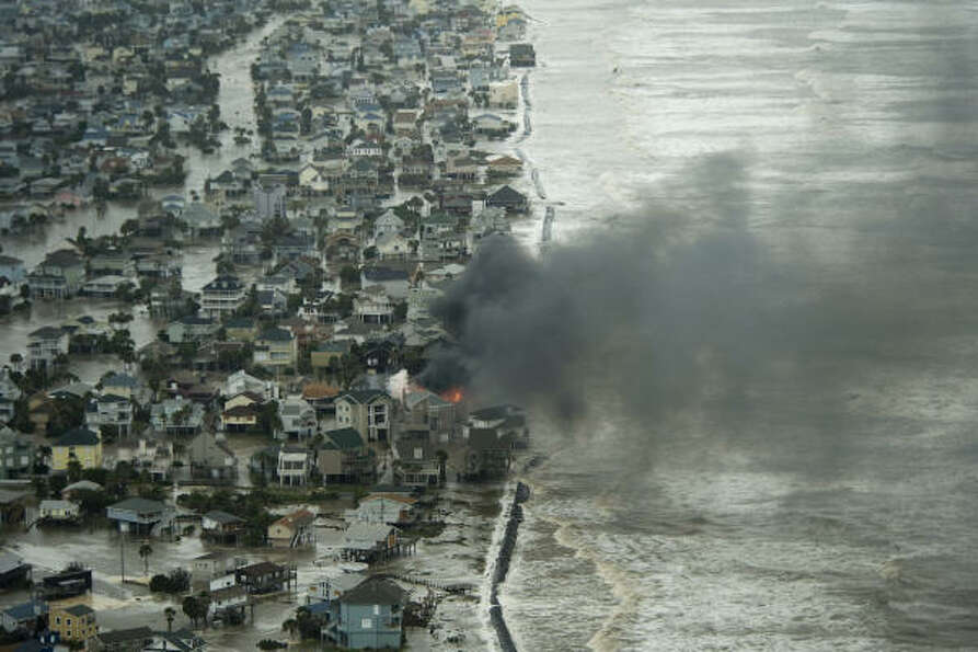 A house burns on Galveston Island.