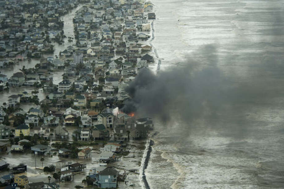 A house burns on Galveston Island. Photo: Smiley N. Pool, Chronicle