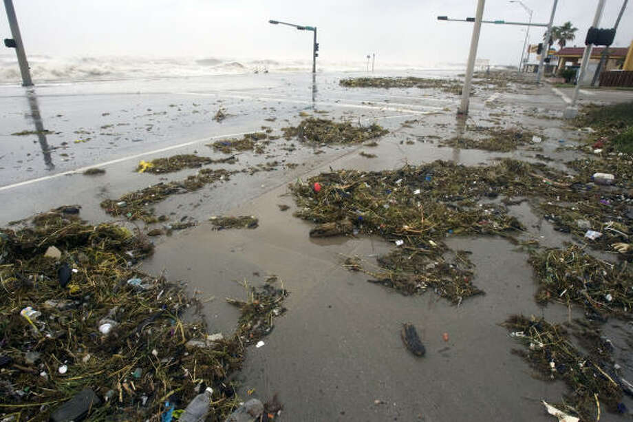 Debris is washed up on Galveston's seawall. Photo: Johnny Hanson, Chronicle