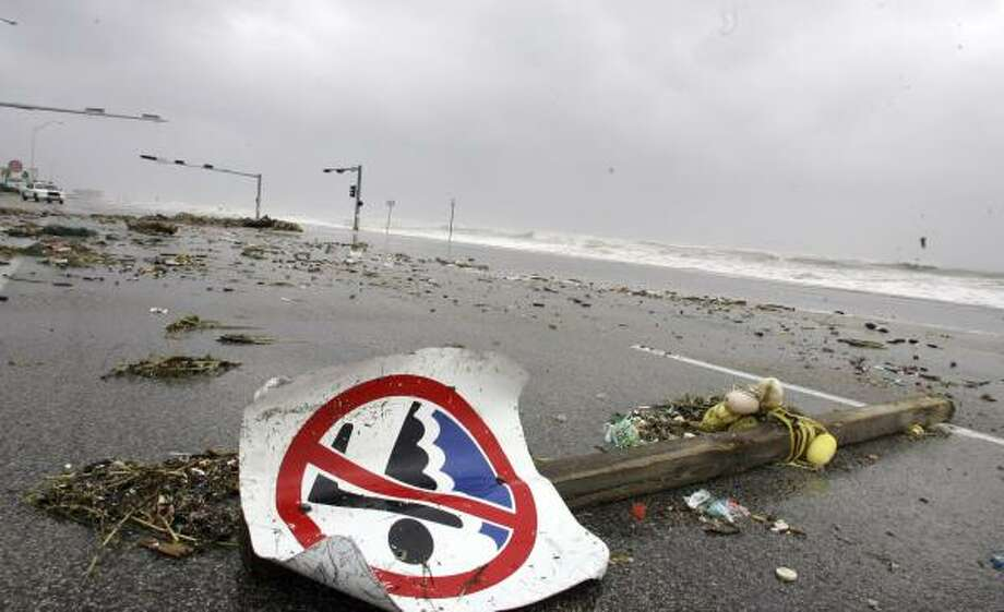 Debris washed ashore by Hurricane Ike lay on the road atop the sea wall in Galveston. Photo: LM Otero, AP