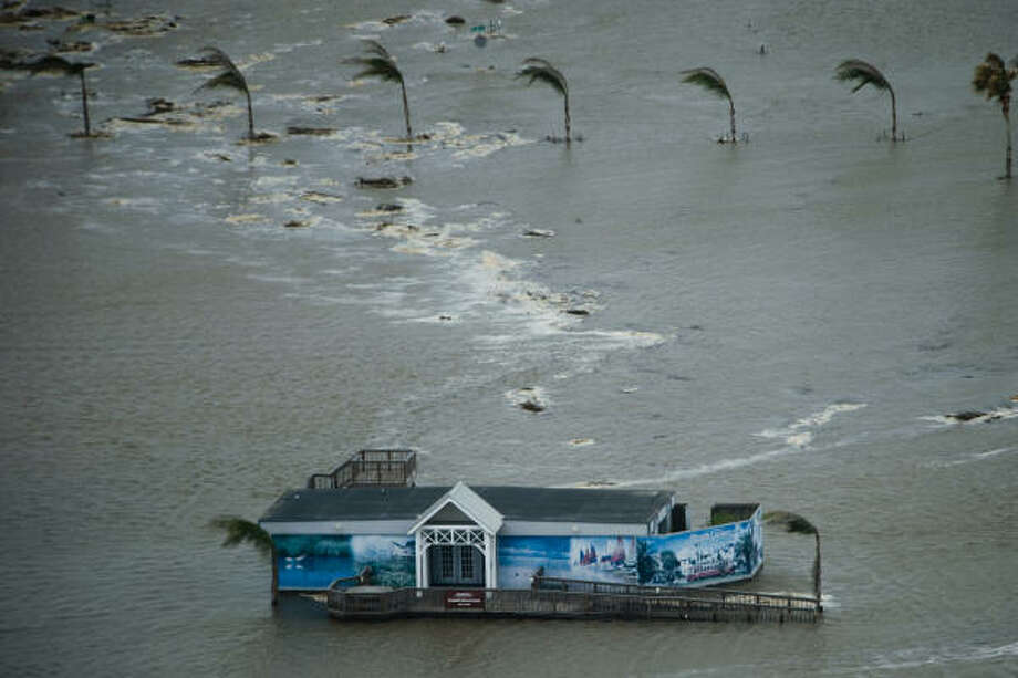 Flood waters surround a real estate office on Galveston Island as Hurricane Ike approaches the Texas Gulf Coast. Photo: Smiley N. Pool, Chronicle