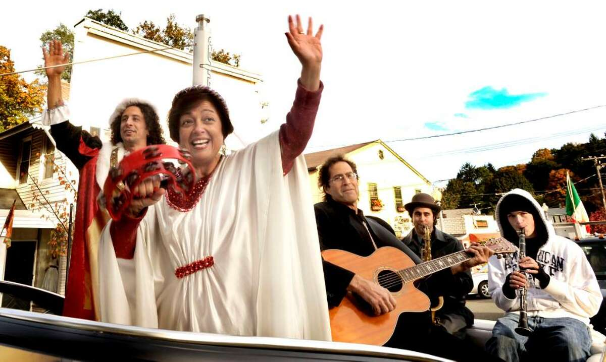 Rob Volpintesta as Christopher Columbus, left, Gina Clarizio as Queen Isabella, Billy Michael and his Jazz For Juniors All-Star Alumni: Will Michael and Billy Podrazky, arrive by boat to P.T.Barnum Square at the start of the Bethel Columbus Day Parade on Monday, Oct.12,2009.