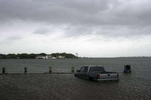 A cars sits half underwater near the causeway on 61st Street as Hurricane Ike approaches Galveston Island Friday. Photo: Johnny Hanson, Chronicle