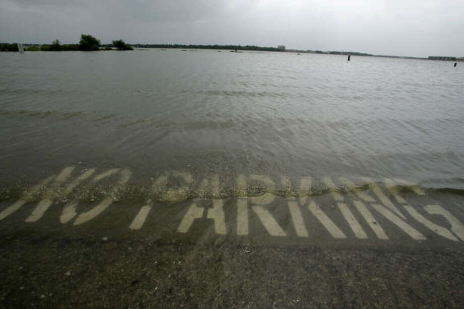 Water rises near a public boat ramp in Nassau Bay. Photo: Frank Franklin II, AP