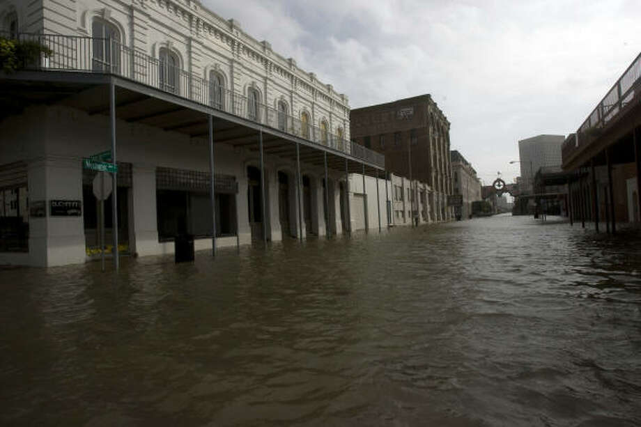 The Strand in Galveston had a 1-1/2 feet of water at 25th Street and Mechanic Friday. Photo: Johnny Hanson, Chronicle