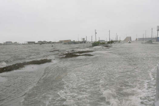 Water from Ike's storm surge covered Highway 332 Friday in Surfside Beach. Photo: Julio Cortez, Chronicle