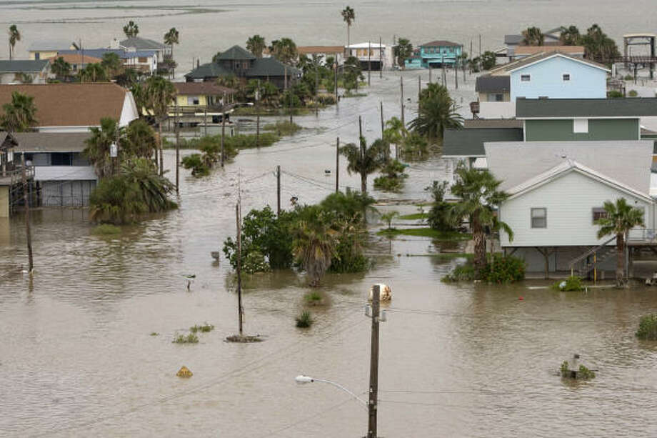Floodwaters lap at homes in Surfside Beach Friday. Photo: Brett Coomer, Chronicle