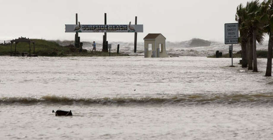 Waves crash into Surfside Beach Friday. Photo: Brett Coomer, Chronicle