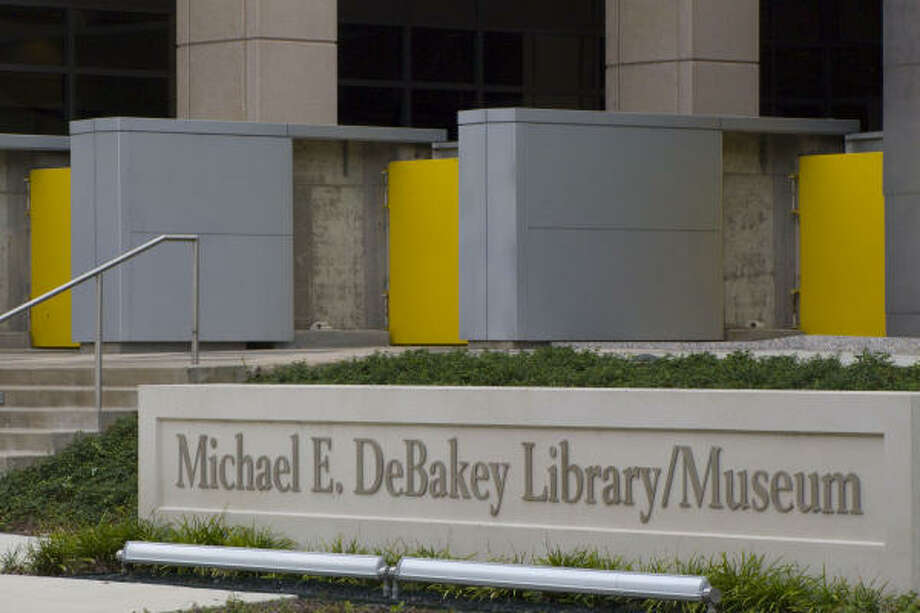At the Texas Medical Center, yellow floodgates are closed at the entrance to Baylor College of Medicine's DeBakey Library/Museum. Photo: Steve Ueckert, Chronicle