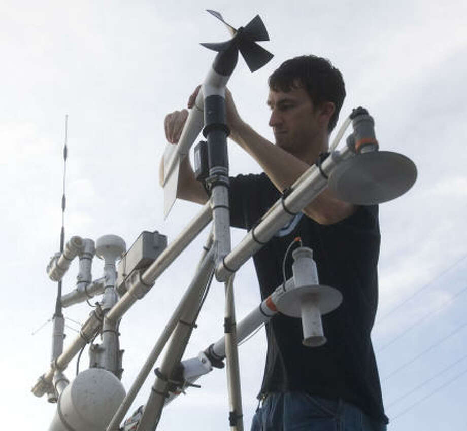 Sean Waugh, a storm researcher from the University of Oklahoma and the National Oceanic and Atmospheric Administration, checks his weather sensing equipment Friday in Bay City. Waugh is a member of a team deployed to the Gulf coast to collect data on Hurricane Ike as it makes landfall. Photo: Brett Coomer, Chronicle
