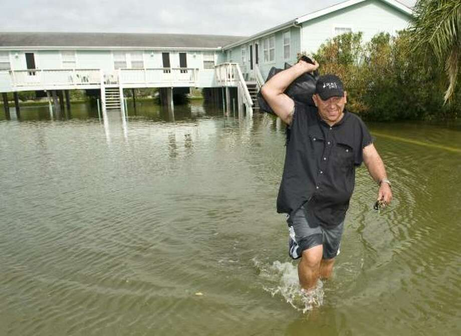 Louis Trejo removes some final items from his Seabrook home Friday. Photo: Dave Einsel, Getty Images