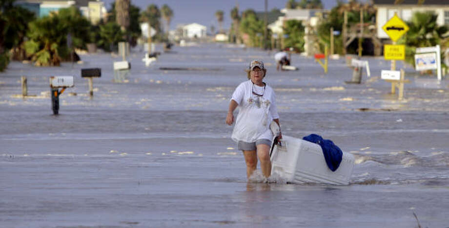 Diane Hall evacuates from Surfside Beach. Photo: Eric Gay, AP