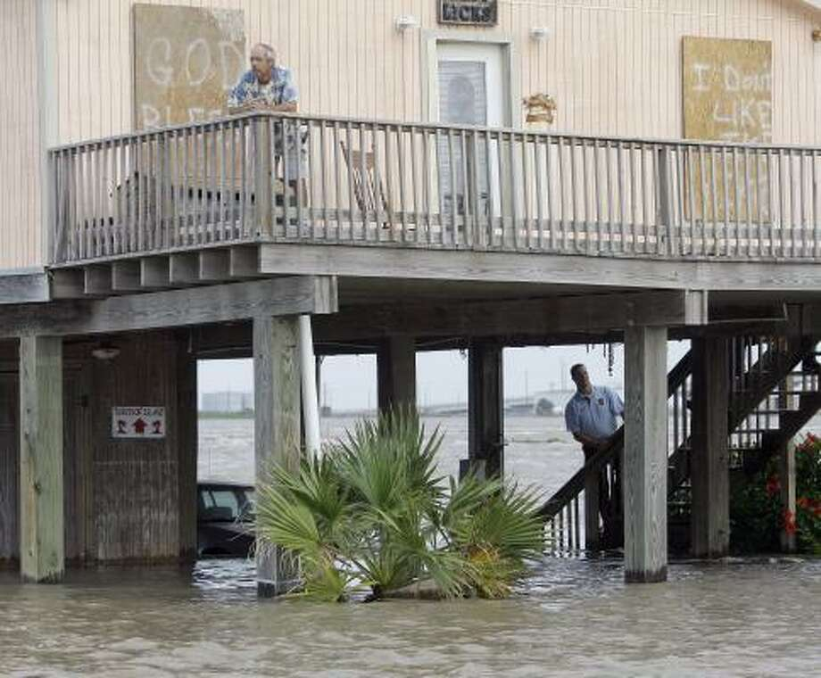 A Surfside Beach police officer checks out a home that wasn't evacuated. Photo: Eric Gay, AP