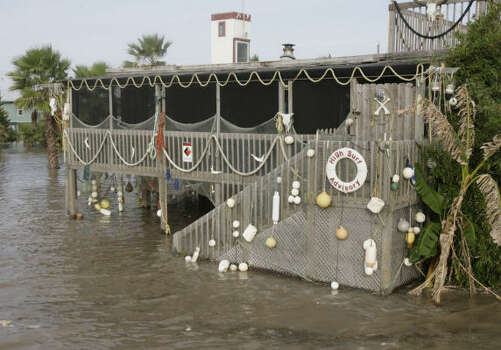 Rising waters threaten a house on Surfside Beach as Hurricane Ike approached Friday. Photo: Julio Cortez, Chronicle