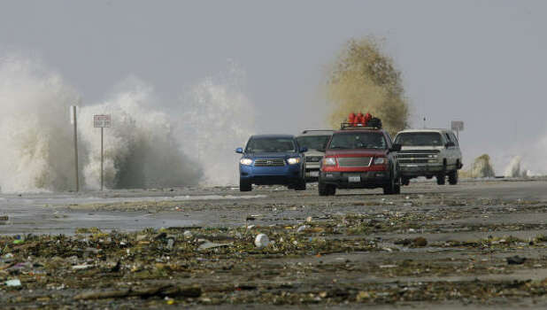 Debris was washing up on Galveston's seawall as waves crashed in from Hurricane Ike Friday. Photo: Matt Slocum, AP