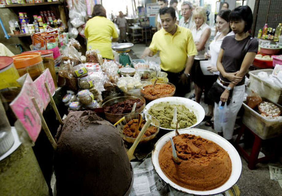Bangkok:I'm addicted to Thai cuisine and fascinated by the city's many cooking schools -- even though I don't cook. Photo: APICHART WEERAWONG, Associated Press