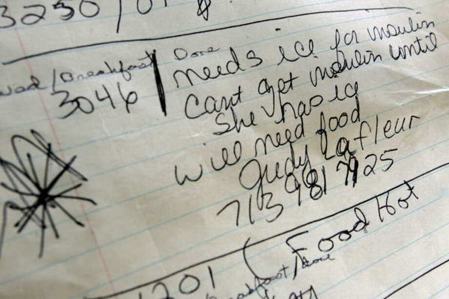 A list notes which neighbors have special needs at the Braesridge Senor Complex. Photo: Eric Kayne, Chronicle