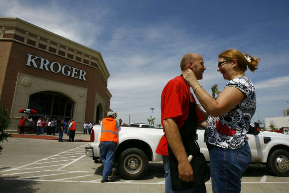 Kroger employee Steve Linton gives one of his favorite customers, Anita Katz Schuler, a hug before Kroger opened Wednesday for the first time since Hurricane Ike in Galveston. Photo: Nick De La Torre, CHRONICLE