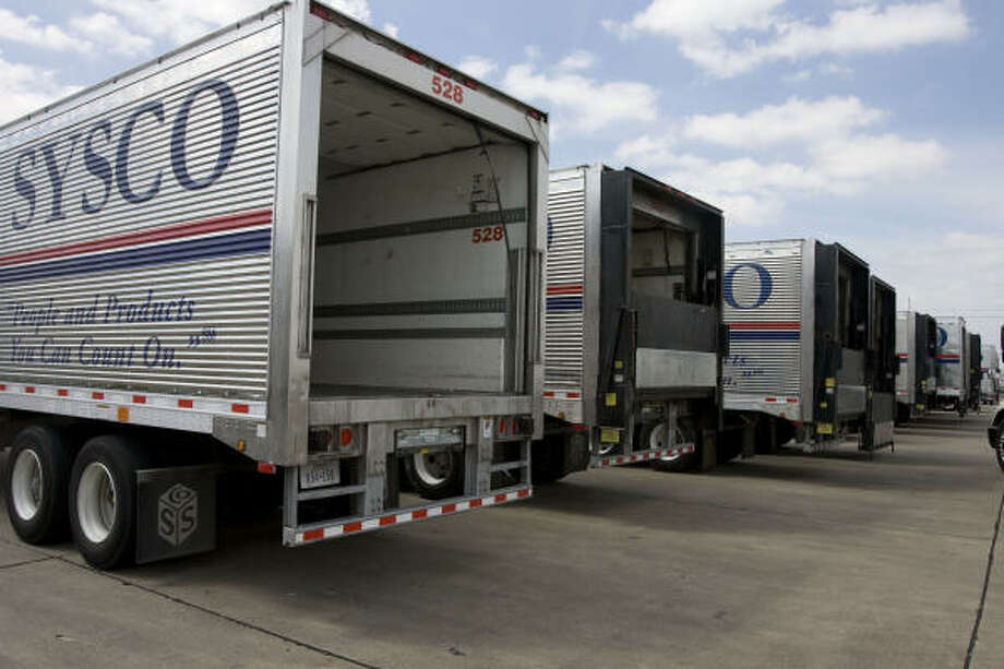 Sysco trucks wait to be loaded with food at the company's distribution center on Wednesday in Houston. Photo: James Nielsen, Chronicle