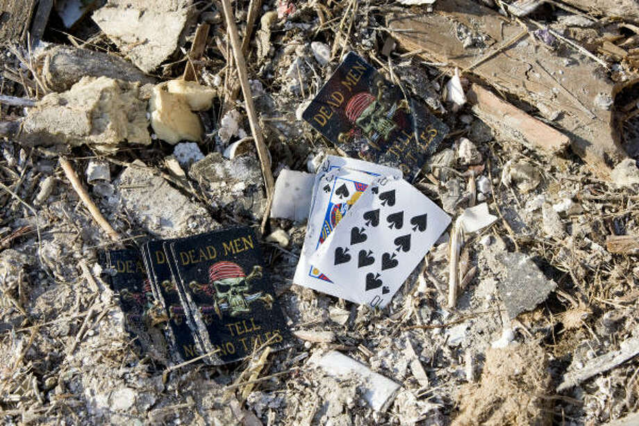 A pack of cards lie among the rubble piled along Seawall Boulevard Wednesday in Galveston. Photo: Brett Coomer, Chronicle