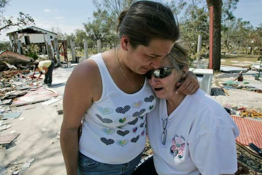 Necie Chenall, left, comforts neighbor Glenda Frascone, who lost her home and family winery to Hurricane Ike in Oak Island on Wednesday. Photo: Marcio Jose Sanchez, Associated Press