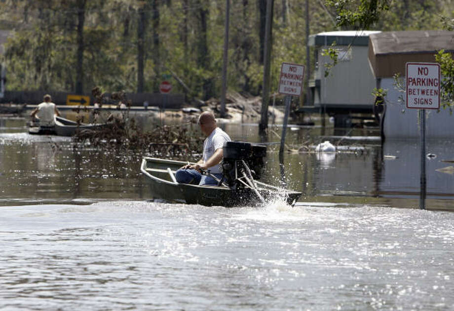 Jacob Lirette uses a boat to get to his house through flood waters in Chauvin, La., on Sept. 17. Photo: Alex Brandon, Associated Press