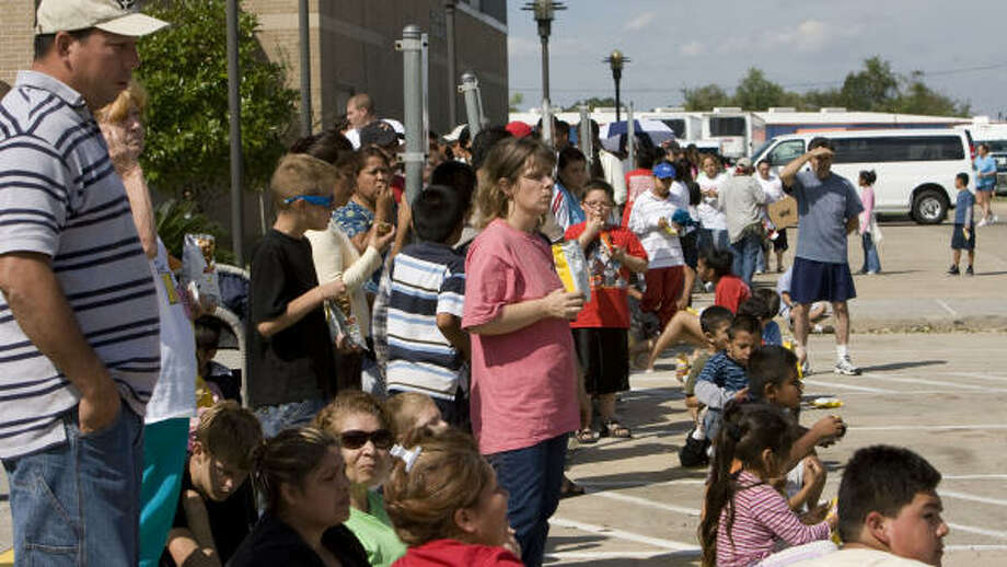 Families affected by Hurricane Ike wait in line at the Salvation Army's Pasadena location. Photo: James Nielsen, Chronicle