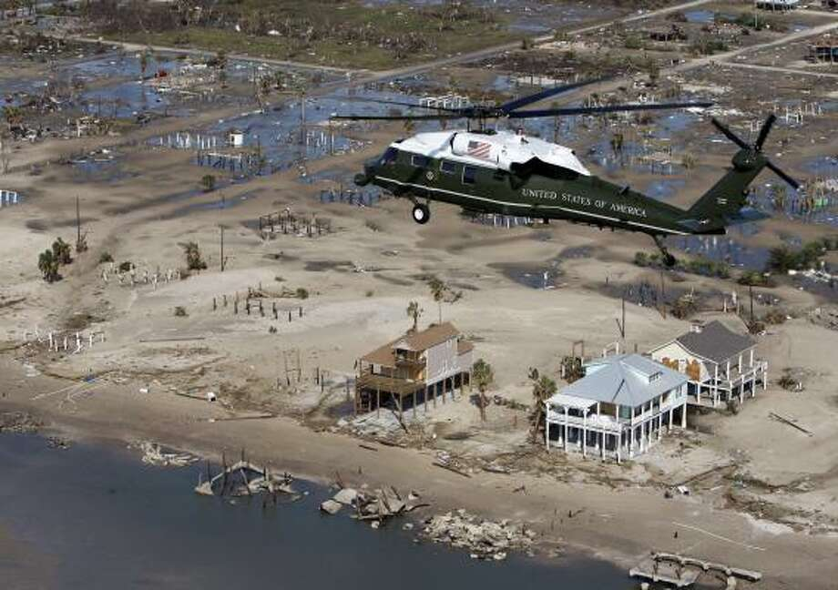 Marine One, with President Bush aboard, takes an aerial tour of the damage from Hurricane Ike Tuesday. Photo: Pablo Martinez Monsivais, AP