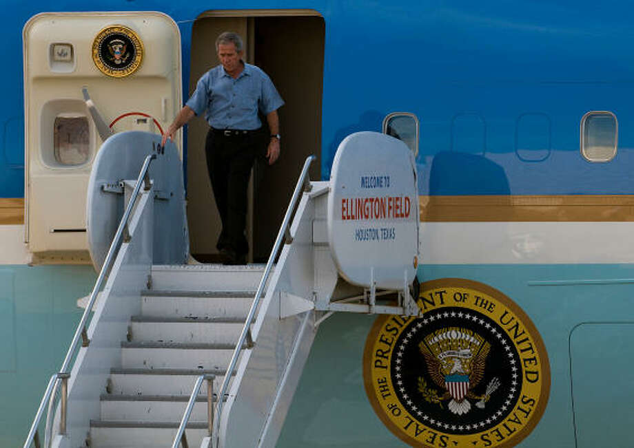 President George Bush arrives at Ellington Field in Houston Tuesday for a tour of areas damaged by Hurricane Ike. Photo: Smiley N. Pool, Chronicle