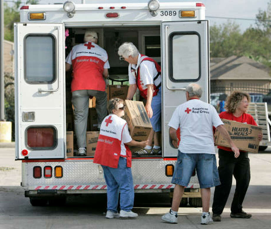 Red Cross volunteers load up their truck with relief supplies Tuesday in preparation for deliveries to Baytown. Photo: Marcio Jose Sanchez, AP
