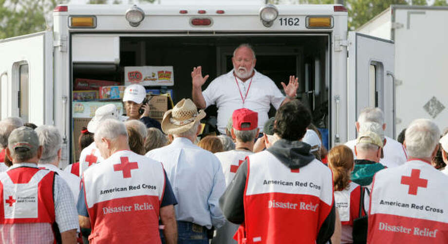 George Douglas, top, instructs Red Cross volunteers on Tuesday's plan to delivery emergency supplies to Baytown. Photo: Marcio Jose Sanchez, AP