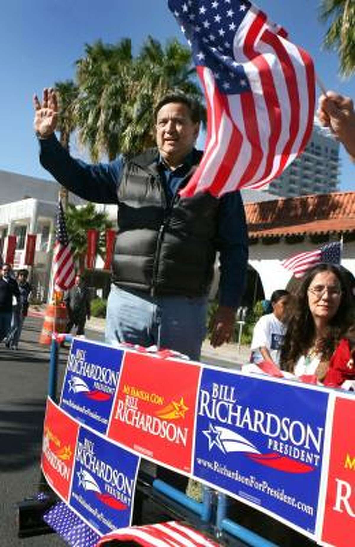 Democratic presidential hopeful New Mexico Gov. Bill Richardson rides in the Hispanic International Day Parade in Las Vegas on Oct. 13. Richardson's Anglo name presents a challenge with Hispanic voters, but, an analyst says, that could be overcome with aggressive outreach in person, on television and in Spanish-language media. Richardson has a Mexican mother and an Anglo father.