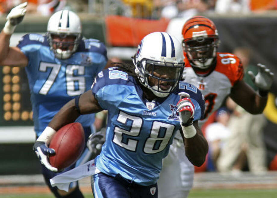 Tennessee 24, Cincinnati 7Titans running back Chris Johnson ran for 109 yards, topping 100 for the first time in his young career. Photo: Tom Uhlman, AP