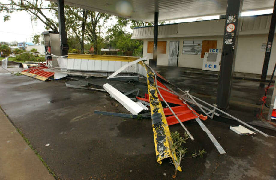 Many of the service stations overhangs blew down in Pearland.  This station was located on 518 and Patricia Lane. Photo: Jimmy Loyd, For The Chronicle
