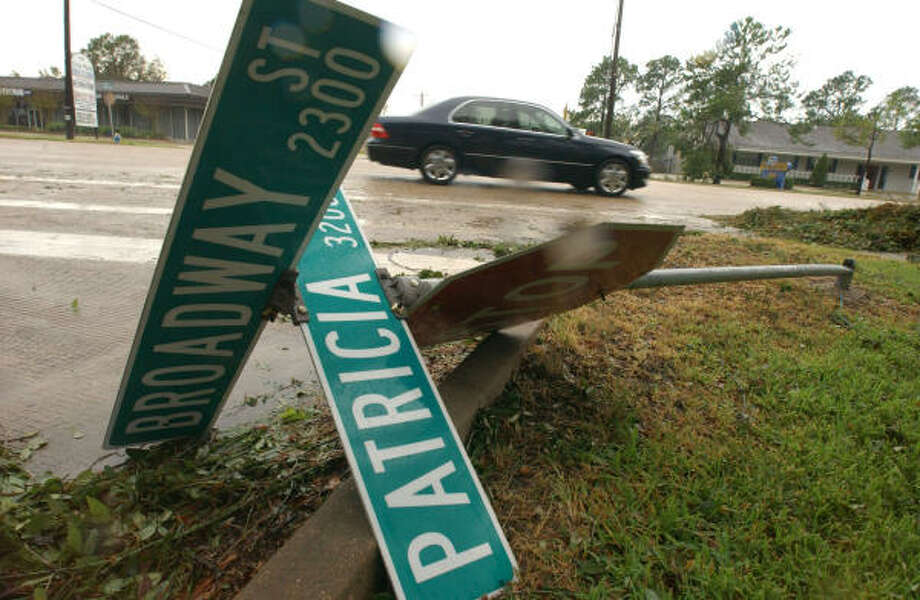 Many of the Pearland signs were blown over during Hurricane Ike all along 518 and side roads. Photo: Jimmy Loyd, For The Chronicle