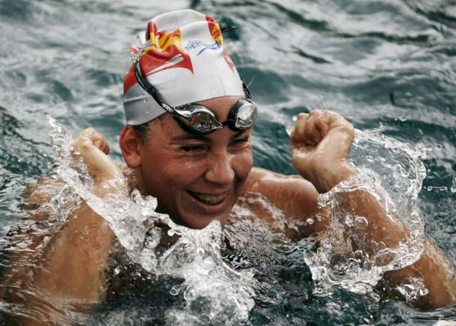 Open-water swimming: Spain's Margarita Dominguez notes her win Sunday in a 15.5-mile race in Dubrovnik, Croatia. The sport has a rich history with swimming events at the first Olympics (Athens in 1896) being held in open water. Photo: Filip Horvat, AP