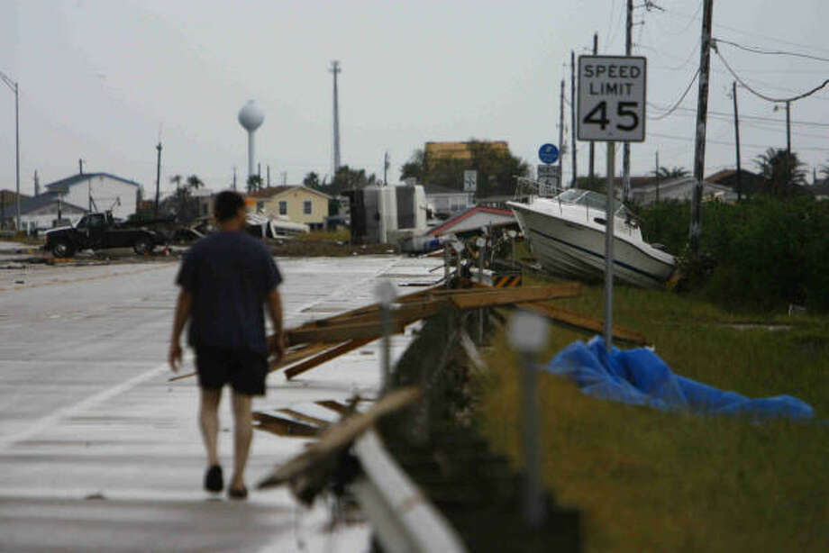 A man who asked not to be identified assesses damage from Hurricane Ike in Hitchcock on Sunday. Photo: Nick De La Torre, CHRONICLE