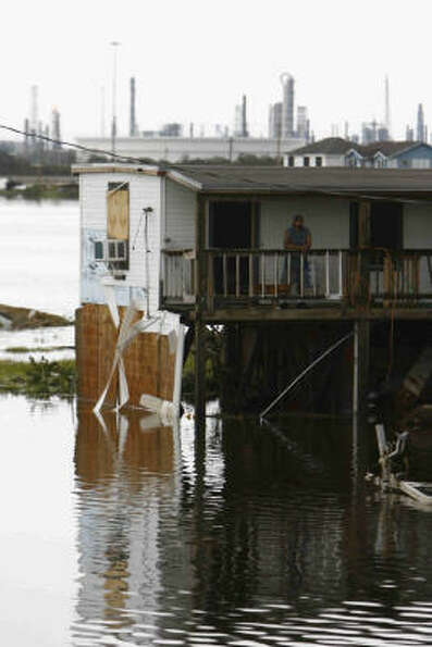 A stranded man waits at the Louis Bait Shack in Hitchcock, Texas, Sunday in the aftermath of Hurrica