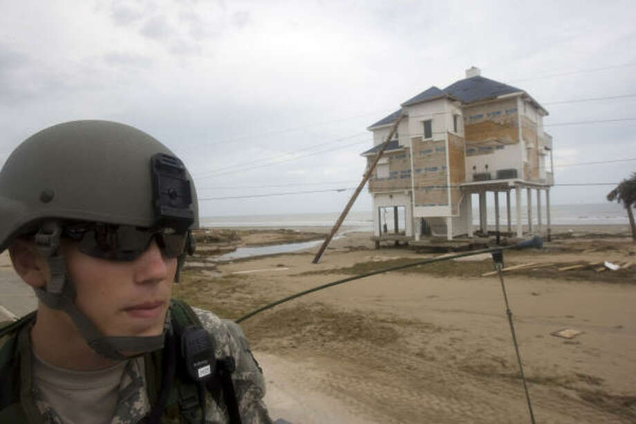 Traveling in a Humvee past the destruction left by Hurricane Ike, Pfc. Chris Seets with the Army National Guard C-Troop, travels along FM 3005 to pick up two stranded women on Galveston Island's west side. Photo: Johnny Hanson, Chronicle